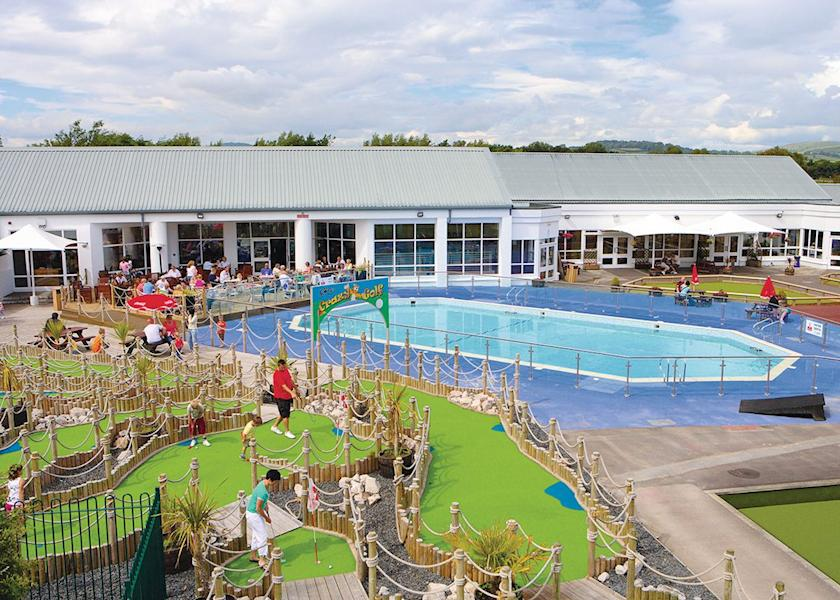 Image shows outdoor swimming pool and mini golf