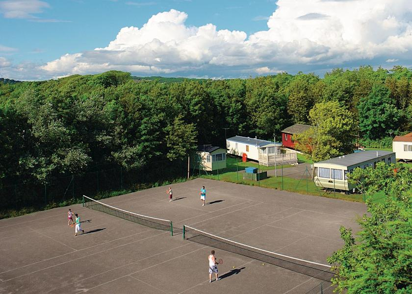 Image shows outdoor tennis courts