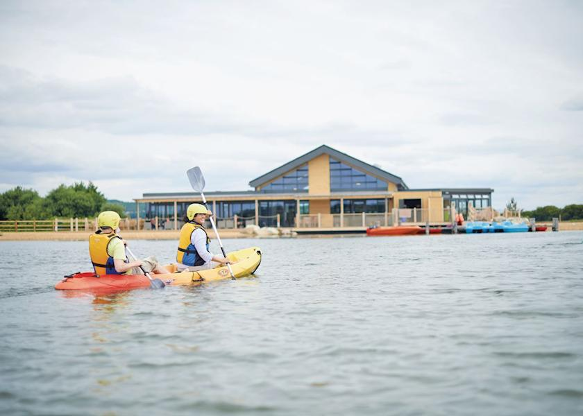 Image shows kayaks on the lake