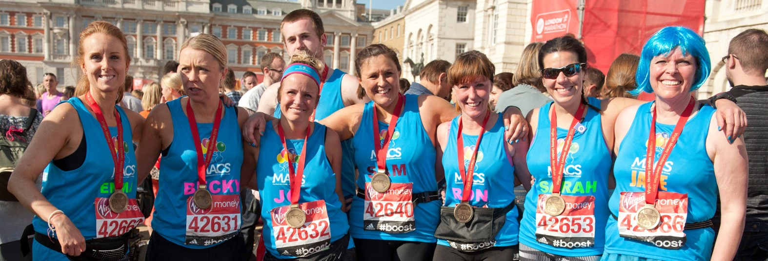 Image shows a group of MACS runners with their medals